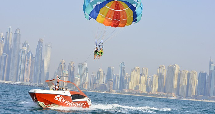 View the city from a new perspective with the parasailing experience, water sports in dubai