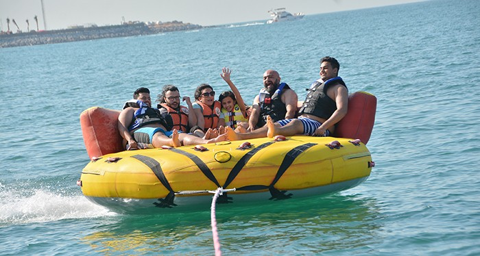 Have a splash with your loved ones with the donut ride experience, water sports in dubai